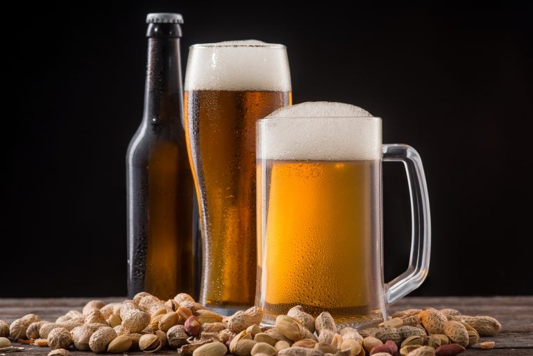 picture of beer glass and bottle and peanuts
