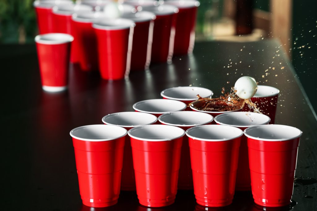 beer pong plastic cups and ping pong ball