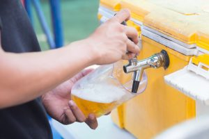 pouring draft beer from a jockey box