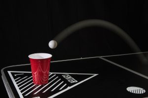 beer pong cup and ping pong ball