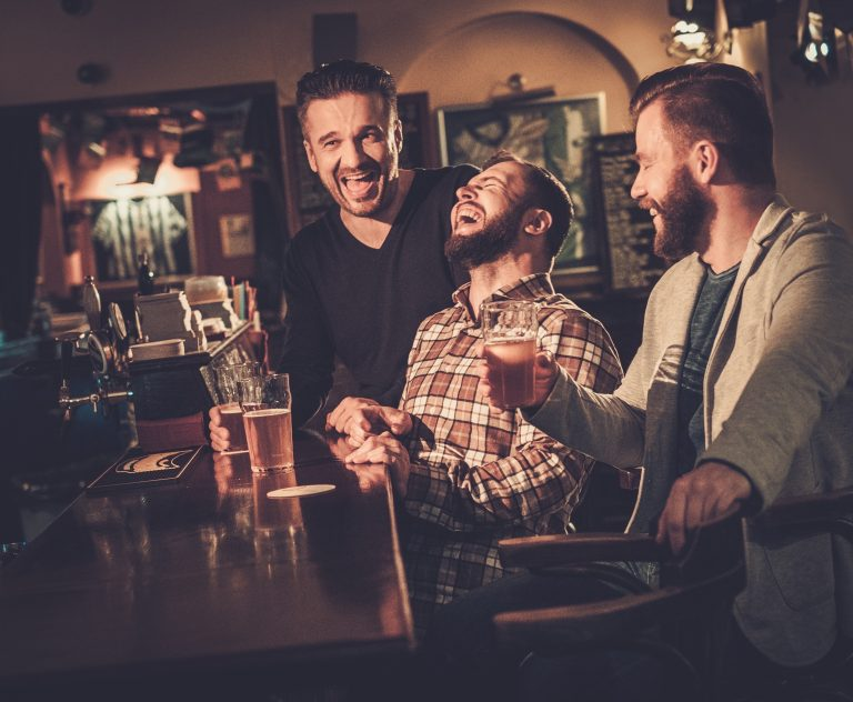 friends laughing and drinking beer