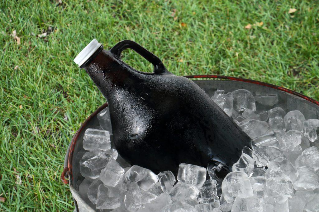 beer growler in a bucket of ice