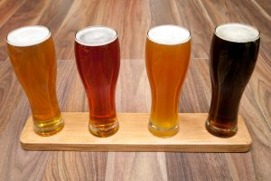 beer flight on wooden paddle