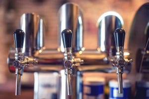 beer taps at a restaurant and bar